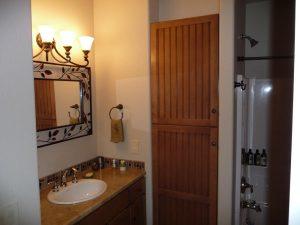 A bathroom as part of a basement finish.
