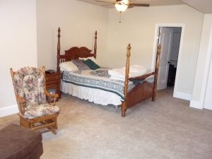 This is a bedroom as part of a basement finish