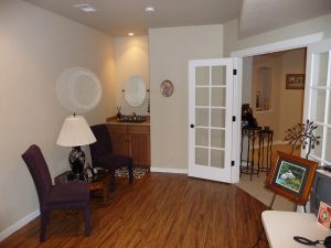 This is a den in a basement finish with a hardwood floor.