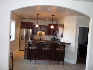 This is a full kitchen in a basement finish.