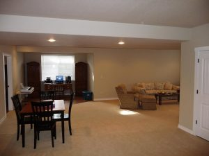 This is the great room of a finished basement.