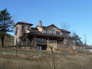 a custom built Colorado foothills home, front view