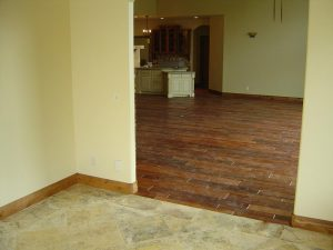 This picture shows the wood and tile flooring in a custom home.
