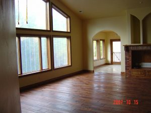 This is the great room with huge windows in a custom home.