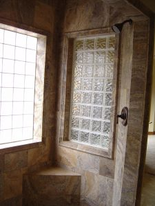 this is the custom tile shower with glass block windows in a custom home.