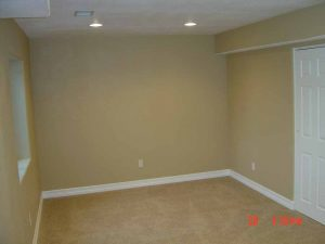 This is a bedroom in a basement finish.