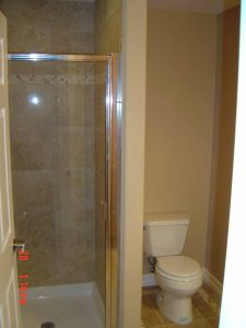 Here is a basement finish bathroom shower and toilet.