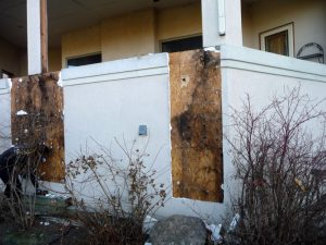 This shows exposed water damage on the exterior of a house.