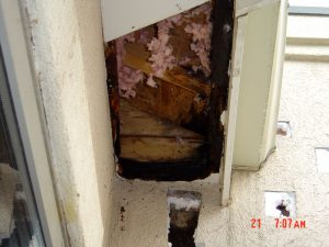 This is a close up of water damage on the exterior of a house.