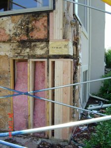 Shown here is water damage found under an exterior wall.