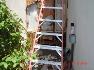 This is an image of an exterior wall with water damage.