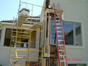 This is a picture of a water damaged exterior wall being repaired.