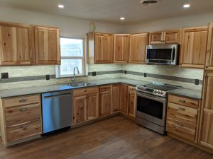Shown here is a kitchen remodel with beautiful wood cabinets.