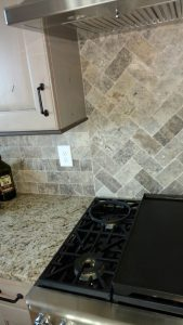 This image is a close-up of custom kitchen tile work.