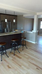 This is a complete kitchen remodel with cabinets, floors and tile work.
