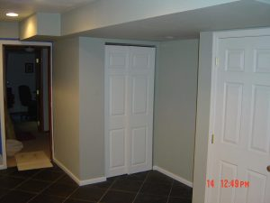 This is a basement finish hallway with doors and a closet.