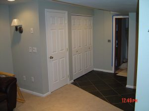 This is a basement finish showing doors and a closet.