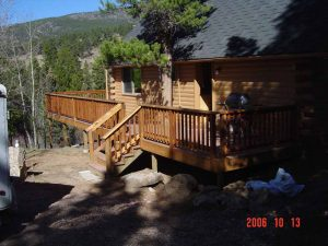 This picture shows the front and deck of a cabin remodel.