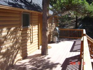 This is the exterior and deck of a full cabin remodel.