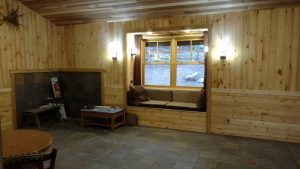 This is the interior of a custom cabin, including a window seat.