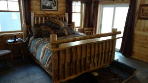 This is the bedroom inside a custom cabin.