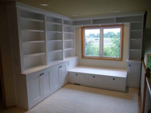 Here is a closet remodel with built-in shelves and cupboards.