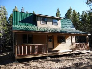 This is the front view of a custom built Colorado cabin.