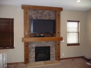 This is a custom stone fireplace with a wood surround.