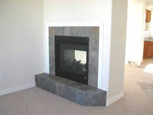 This is a two-sided fireplace in a custom home.