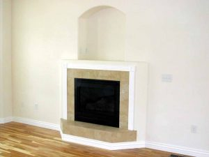 In this picture is a fireplace in a custom home.