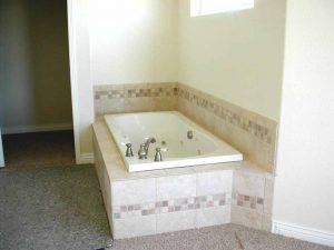 This is a jetted tub in a custom built home.