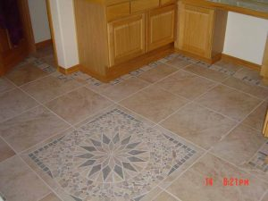 This shows a custom inlaid tile pattern in a kitchen floor