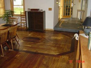 Shown here is a custom wood floor with inlaid design.