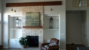 This shows a custom built fireplace and shelves.