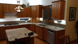 This is a complete kitchen remodel with wood cabinets.