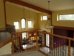 This shows the downstairs living area from the upstairs loft in a custom home remodel.